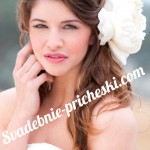 Девушка в свадебной платье с прической на длинные волосы с цветами