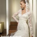 шикарная невеста с прической пучок и фатой