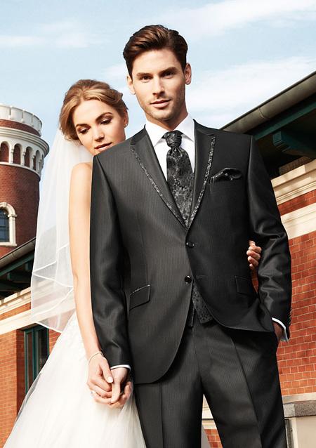 Красивый костюм выгодно подчеркнет элегантность жениха
